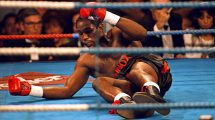 Lennox Lewis hits the floor after a right hand punch from Oliver McCall