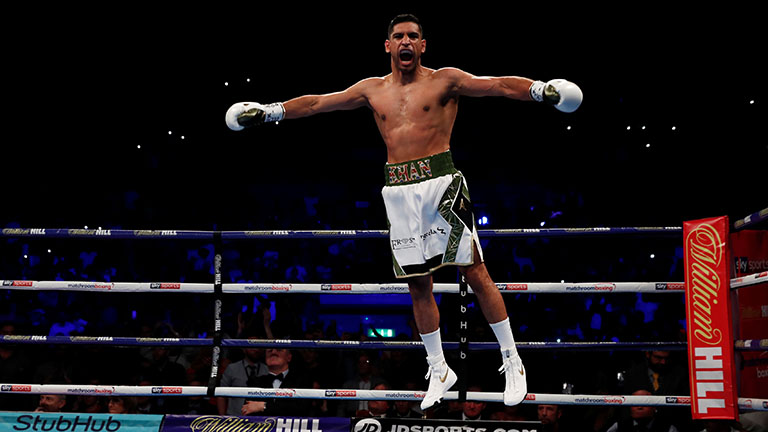 Boxing - Amir Khan v Phil Lo Greco - Echo Arena, Liverpool, Britain - April 21, 2018   Amir Khan celebrates after winning the fight   Action Images via Reuters/Andrew Couldridge