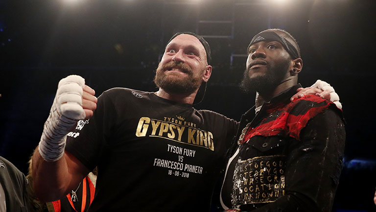 Boxing - Tyson Fury v Francesco Pianeta - Windsor Park, Belfast, Britain - August 18, 2018. Tyson Fury and Deontay Wilder in the ring after the fight. Action Images via Reuters/Lee Smith