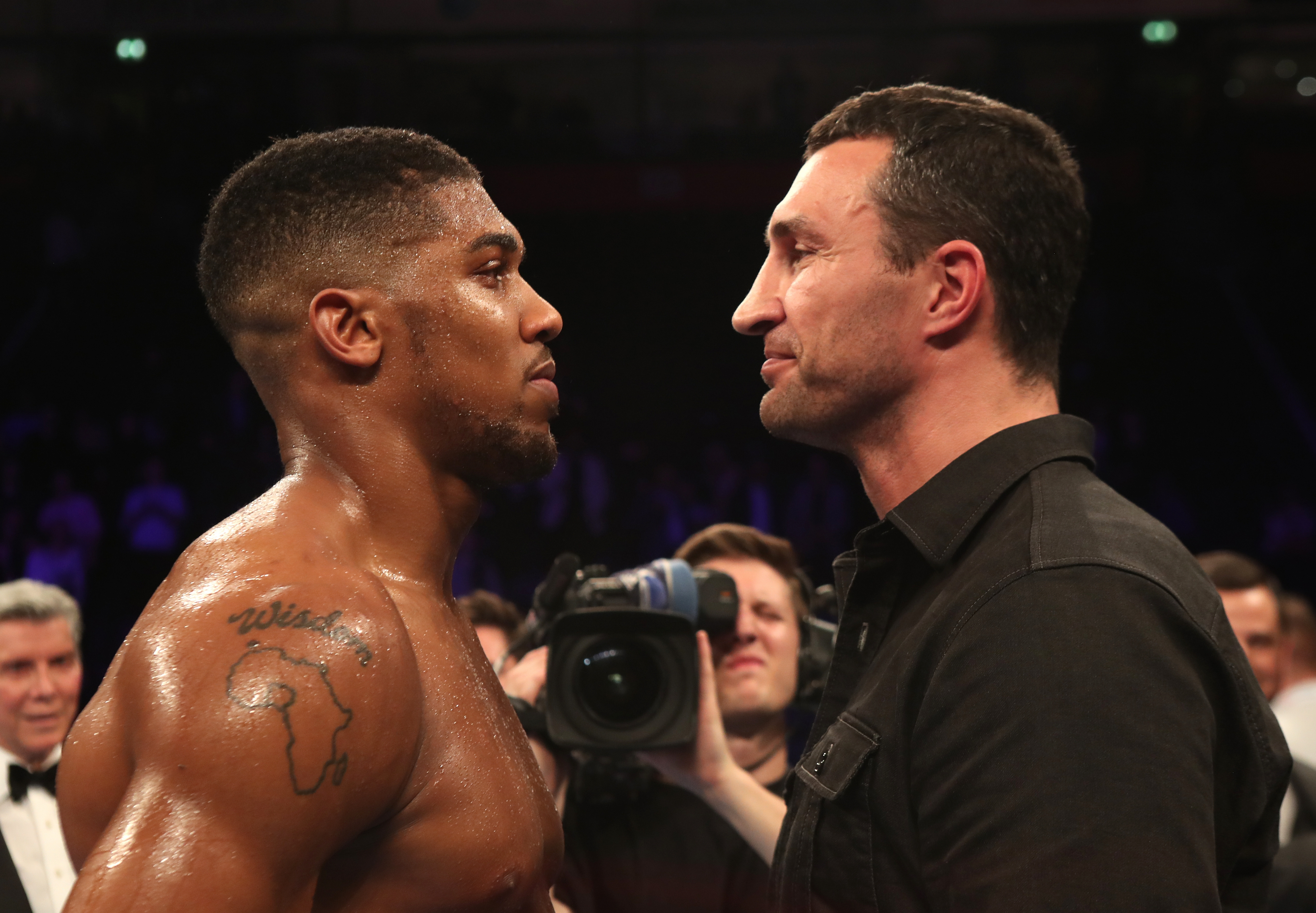 Anthony Joshua, left, and Wladimir Klitschko stand face to face