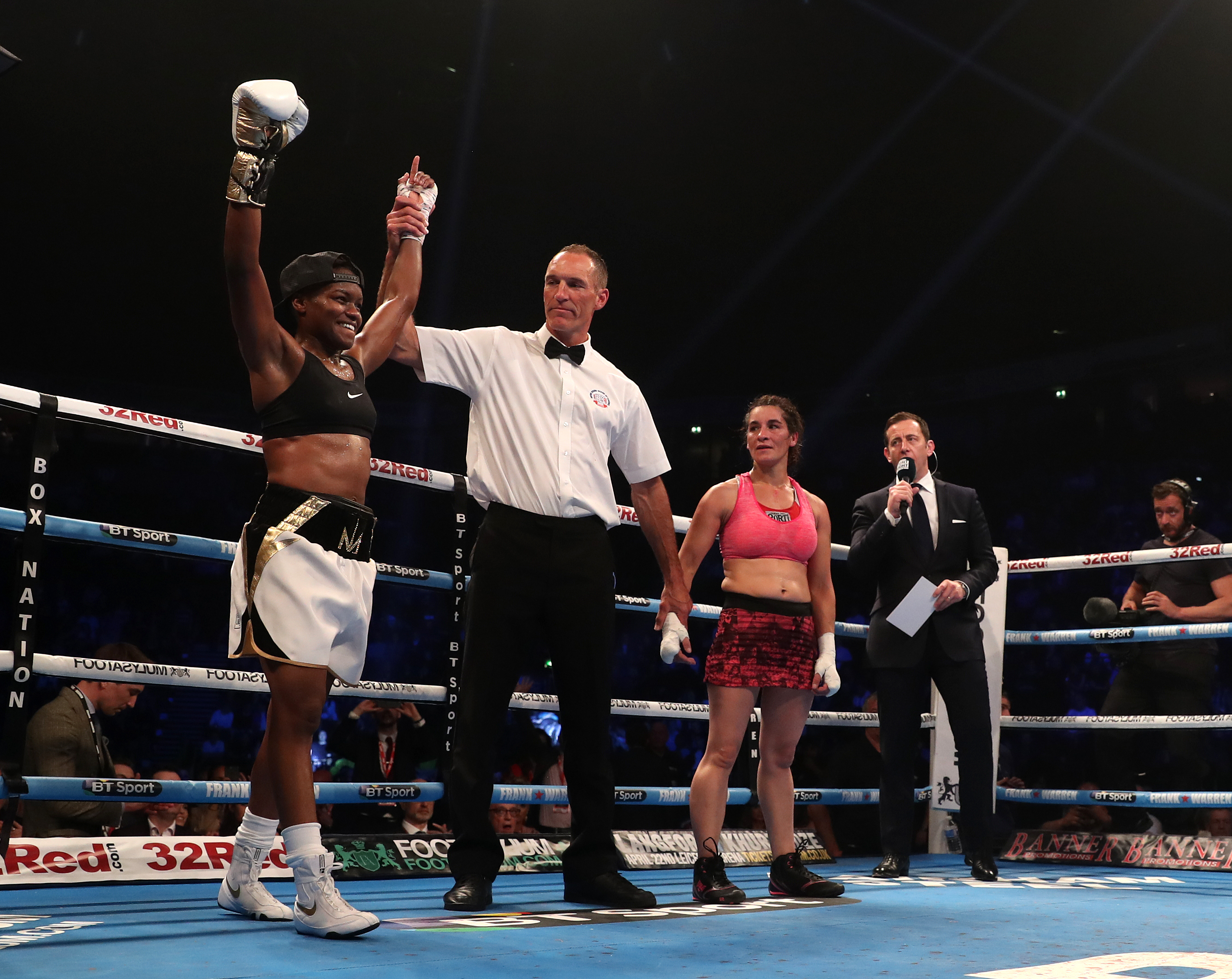 Nicola Adams (left) celebrates victory over Virginia Noemi Carcamo in the International Flyweight Contest at Manchester Arena (Simon Cooper/PA)