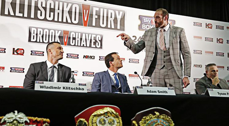 Wladimir Klitschko (L), Tyson Fury (R) and Sky Sports' Adam Smith during the press conference