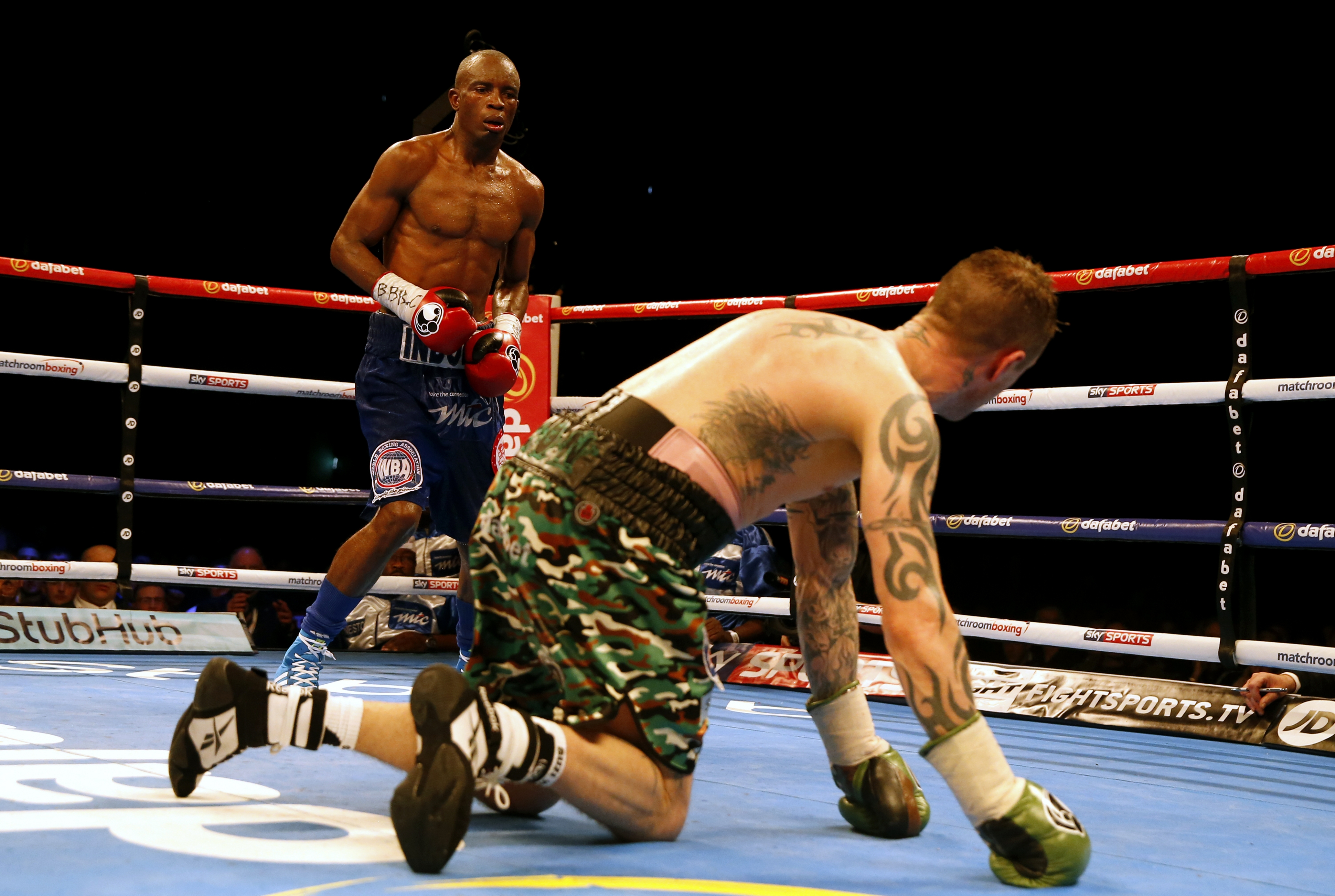 Ricky Burns on his knees against Julius Indongo