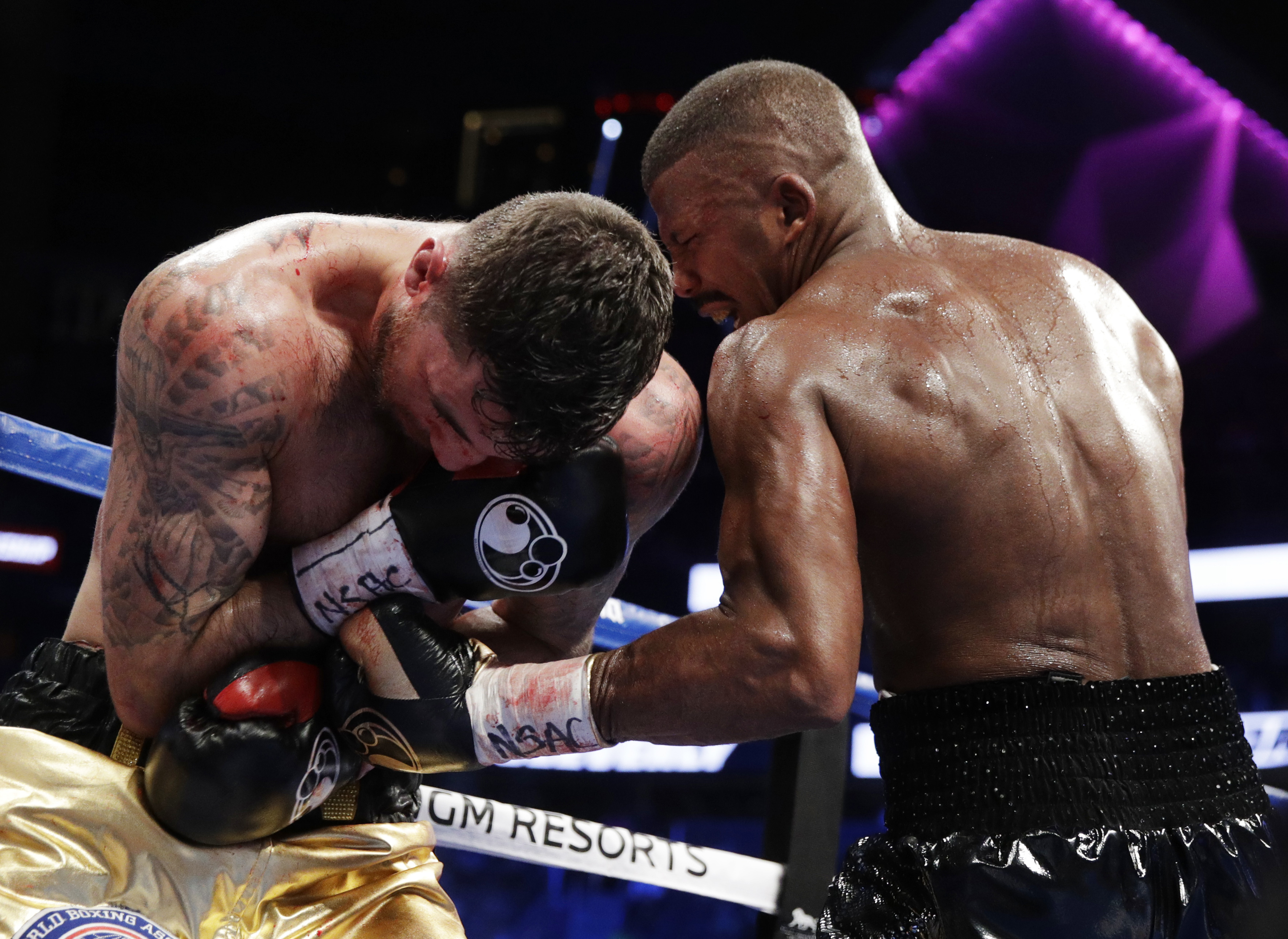 Badou Jack, of Sweden, hits Nathan Cleverly, of Wales