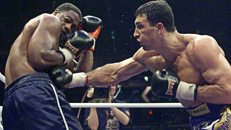 Vladimir Klitschko of Ukraine (R) strikes WBO Heavy-Weight World Champion Chris Byrd of the U.S.A. during their fight in Cologne late October 14, 2000. Klitschko won on points after twelve rounds. JS/WS