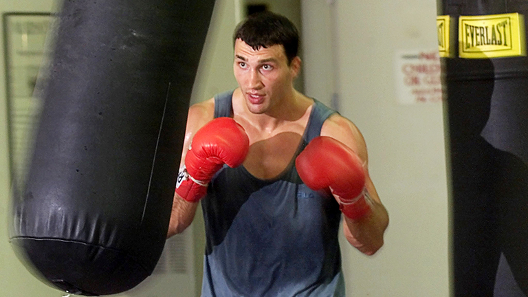 WBO heavyweight champion Wladimir Klitschko works out with a heavy bag at Top Rank Gym in Las Vegas, Nevada July 31, 2001. Klitscho (36-1), originally from Kiev, Ukraine but living in Hamburg, Germany; defends his title against Charles Shufford (16-1) of Las Vegas at the Mandalay Bay Resort & Casino in Las Vegas August 4. SM/SV
