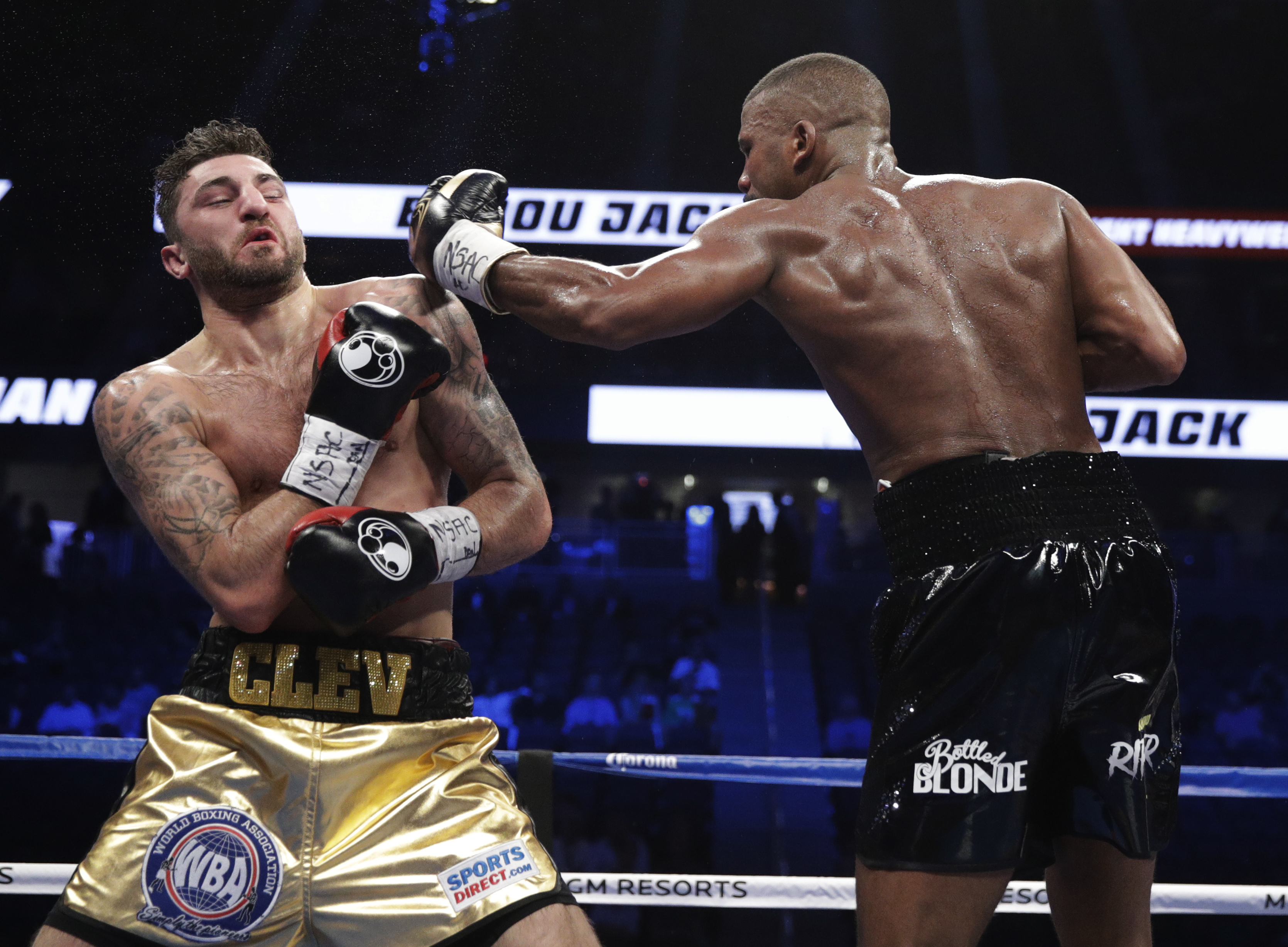 Badou Jack, right, of Sweden, fights Nathan Cleverly