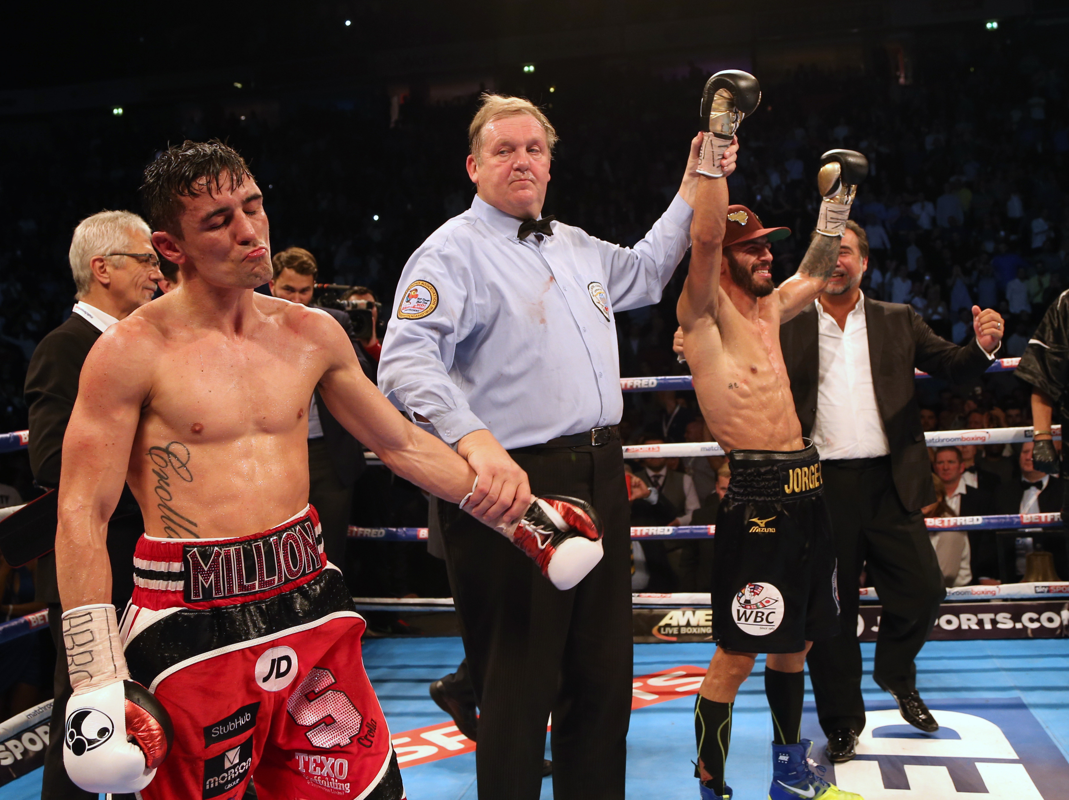 Jorge Linares, second right, celebrates beating Anthony Crolla in September