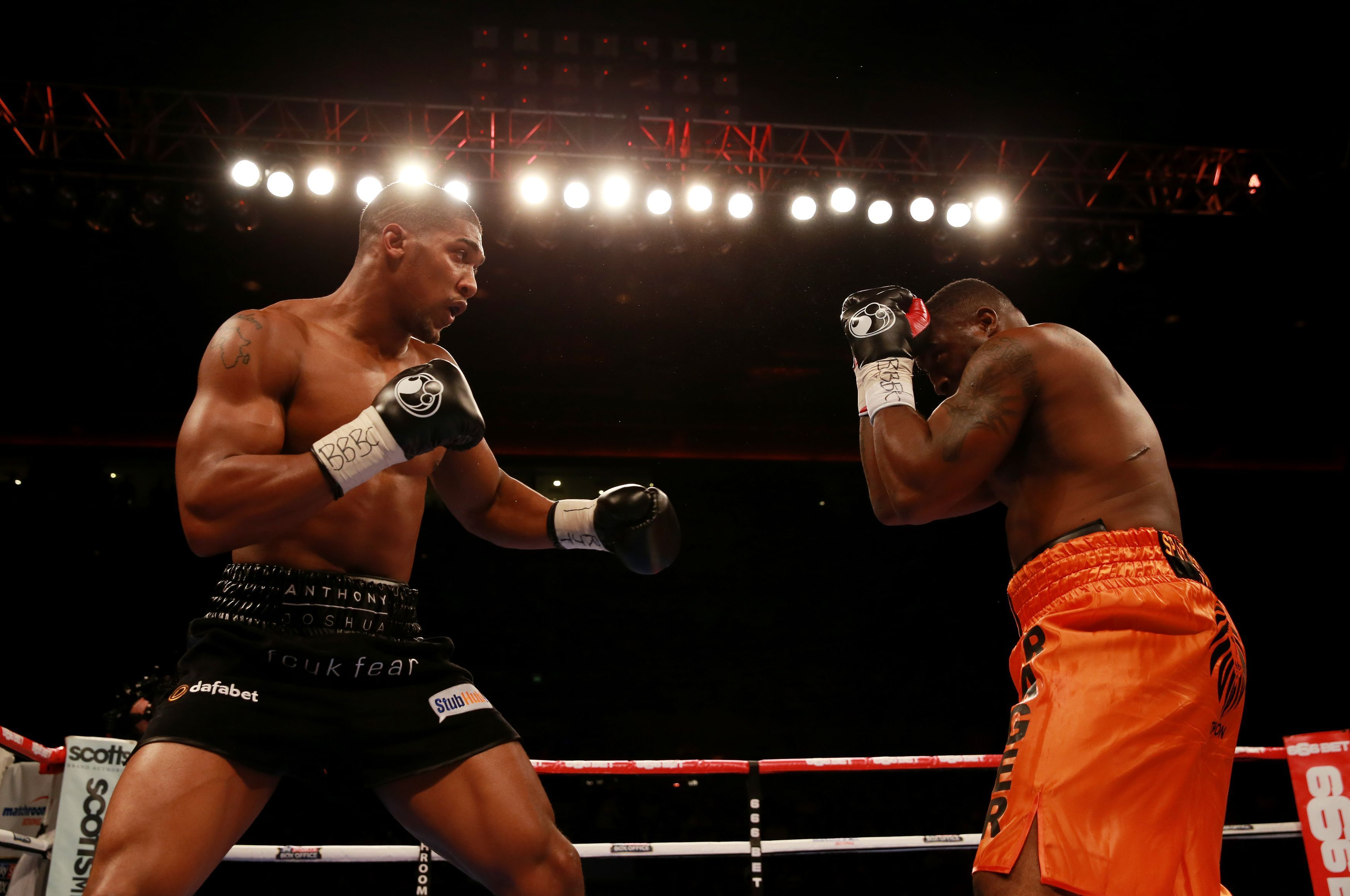 Anthony Joshua, left, in action against Michael Sprott