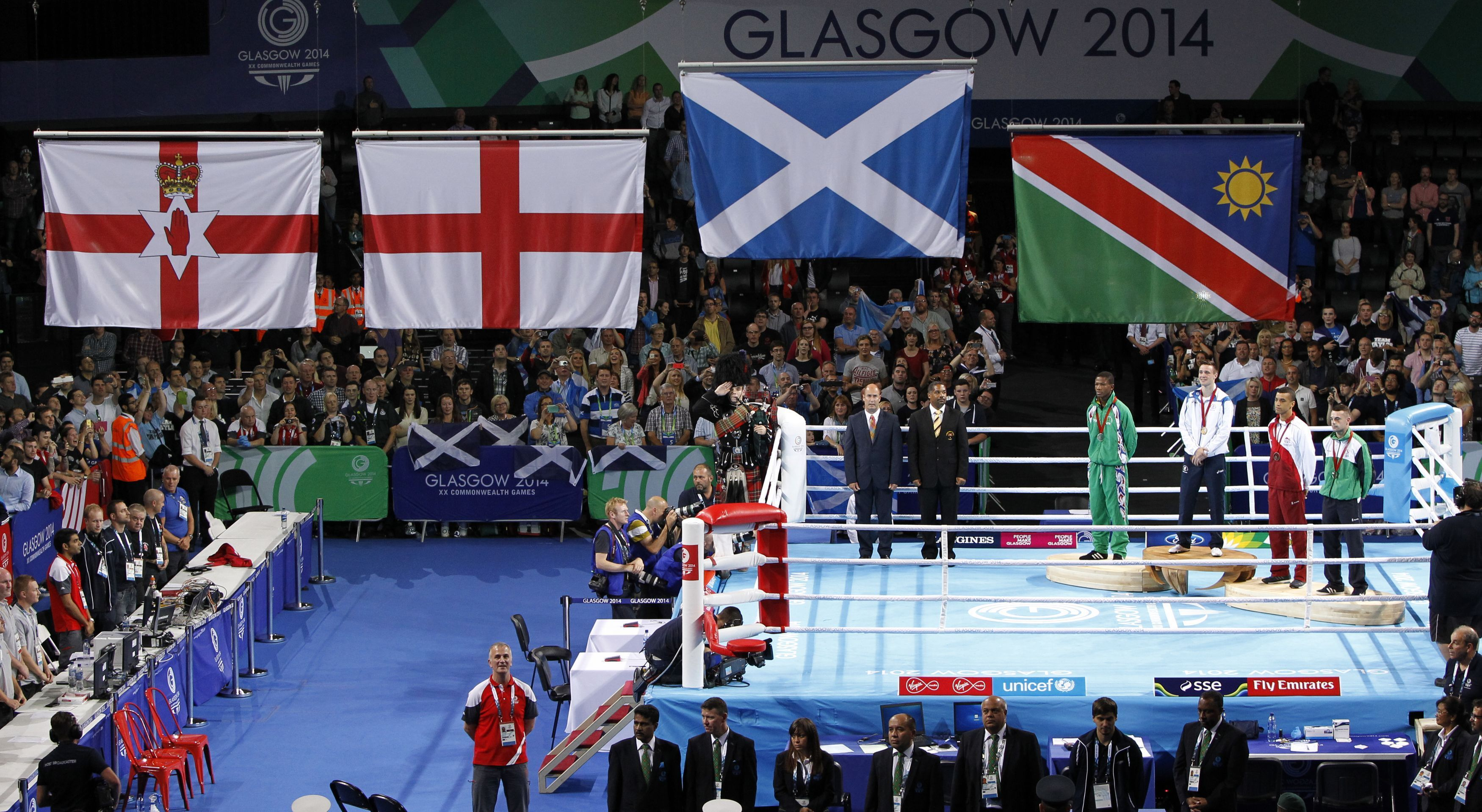 Scotland's Josh Taylor receives his gold medal during the 2014 Commonwealth Games