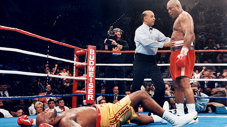 George Foreman knocks out Michael Moorer