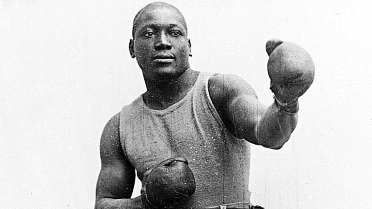4th July 1910:  American boxer Jack Johnson (1878 - 1946), the first African-American World Champion, after he defeated Jim Jeffries in Reno, Nevada.  (Photo by Sean Sexton/Getty Images)