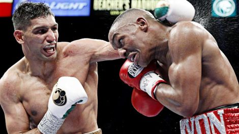 Welterweight boxer Amir Khan (L) of Britain battles with Devon Alexander of the U.S. during a welterweight fight at the MGM Grand Garden Arena in Las Vegas, Nevada, December 13, 2014