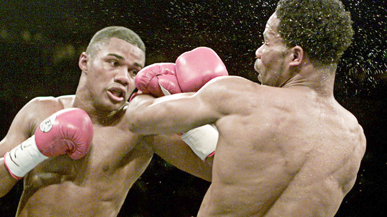 Challenger Felix Trinidad (L) from Puerto Rico hits WBA middleweight champion William Joppy during fourth round action in their title fight in New York May 12, 2001. Trinidad won the championship with a fifth round TKO. GMH/SV Reuters / Picture supplied by Action Images *** Local Caption *** RBBORH2001051300043.jpg