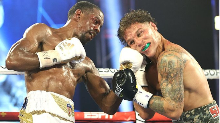 Herring sets up Frampton fight after win by DQ over Oquendo
